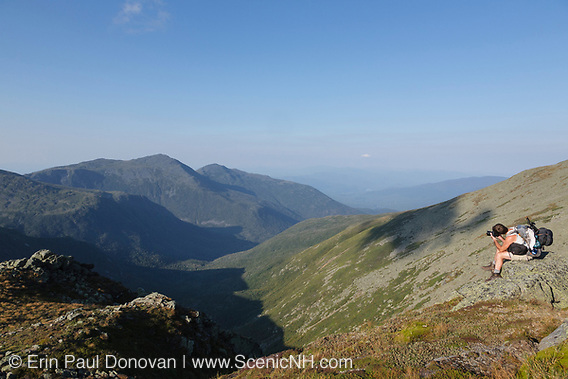 A hiker photographs the Great Gulf from the Appalachian Trail near the summit of Mount Washington in the White Mountains, New Hampshire.