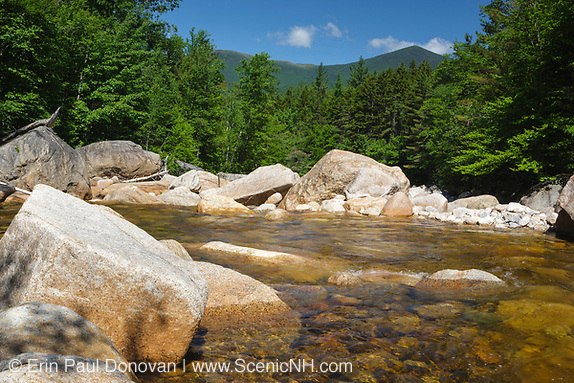 Pemigewasset Wilderness - Just beyond the large boulders is the location of where a timber trestle once spanned the East Branch of the Pemigewasset River in the area of Camp 18 along the East Branch & Lincoln Railroad in Lincoln, New Hampshire USA. This was a logging railroad, which operated from 1893 - 1948. Mount Bond is off in the distance.