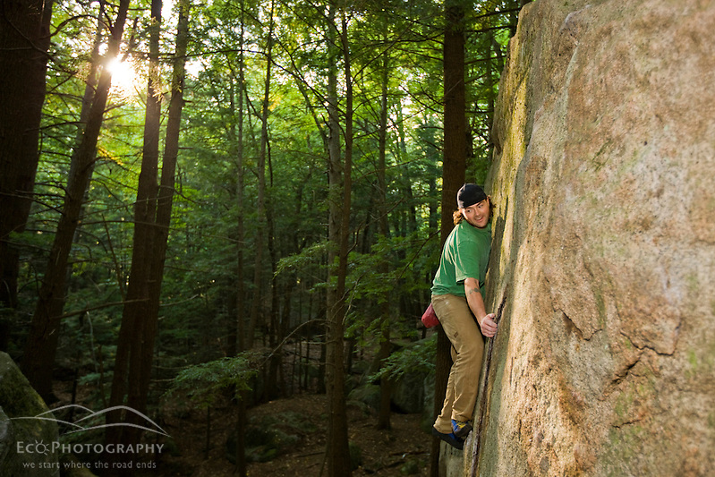"""A man bouldering in """"The Boulders"""" section of New Hampshire's Pawtuckaway State Park. (Jerry and Marcy Monkman)"""