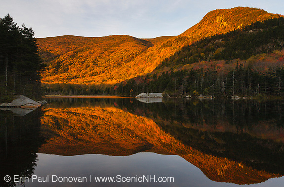 Kinsman Notch - Reflection of mountains in Beaver Pond in the White Mountains, New Hampshire USA during the autumn months.
