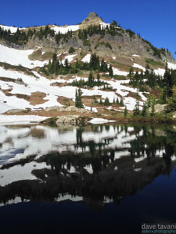 Naches Peak reflects in a small lake along the Naches Peak Loop Trail. (Dave Tavani)