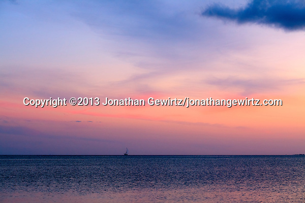 A sailboat cruises at twilight on Biscayne Bay just south of Key Biscayne, Florida. (© 2013 Jonathan Gewirtz / jonathan@gewirtz.net)