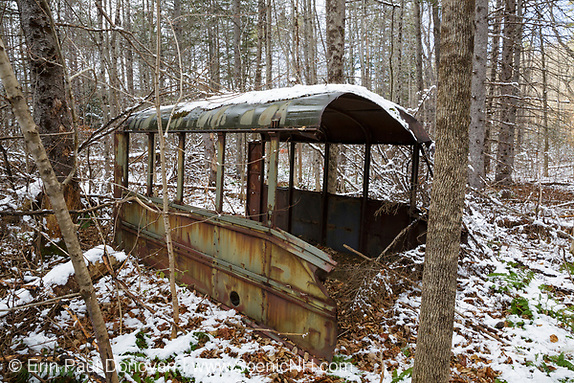 Abandoned bus in the forest of Hastings, Maine during the autumn months. This area was part of the Wild River Railroad, which was a logging railroad in operation from 1891 - 1904.