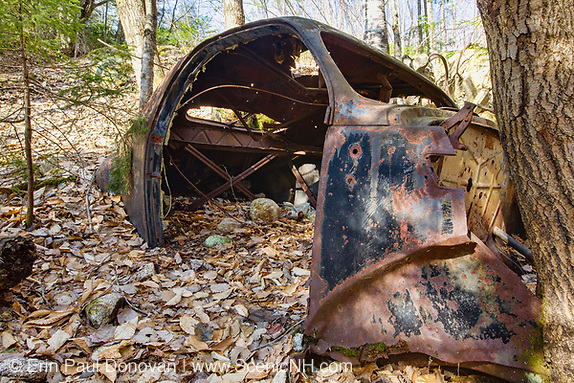 Abandoned old rusted car in the Tecumseh Brook drainage area of Waterville Valley, New Hampshire.