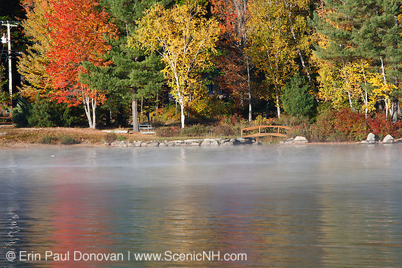 Shore of Newfound Lake from Wellington State Park in Bristol, New Hampshire USA during the autumn months.