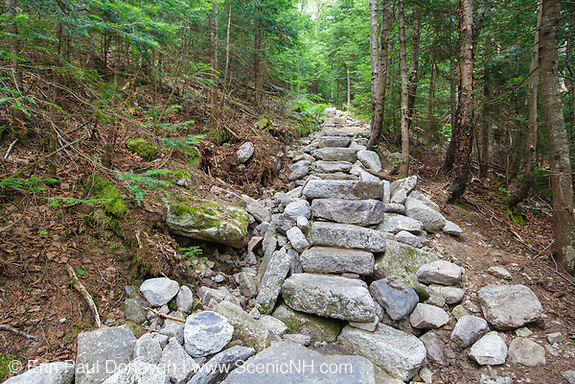 July 2012 - Stone steps along the Mount Tecumseh Trail in the White Mountains, New Hampshire USA. Less than year after being installed and this length of staircase is fallen part. The hillside (left-hand side of the staircase) continues to collapse and erode. After a trail inspection by Forest Service in June 2012, they (FS) stepped in and took control of ongoing work along this trail. It has been suggested this erosion issue will need to be corrected by a professional trail crew.