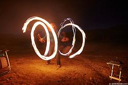 Cherie Ve Ard dances with fire in the Anza Borrego desert of California. (Seth K Hughes)
