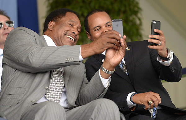 """COOPERSTOWN, NY - JULY 27:  Baseball Hall of Famers Dave Winfield (L) and Barry Larkin take """"selfless"""" prior to the 2014 induction ceremonies held at the Clark Sports Center in Cooperstown, New York on July 27 2014. (Ron Vesely)"""