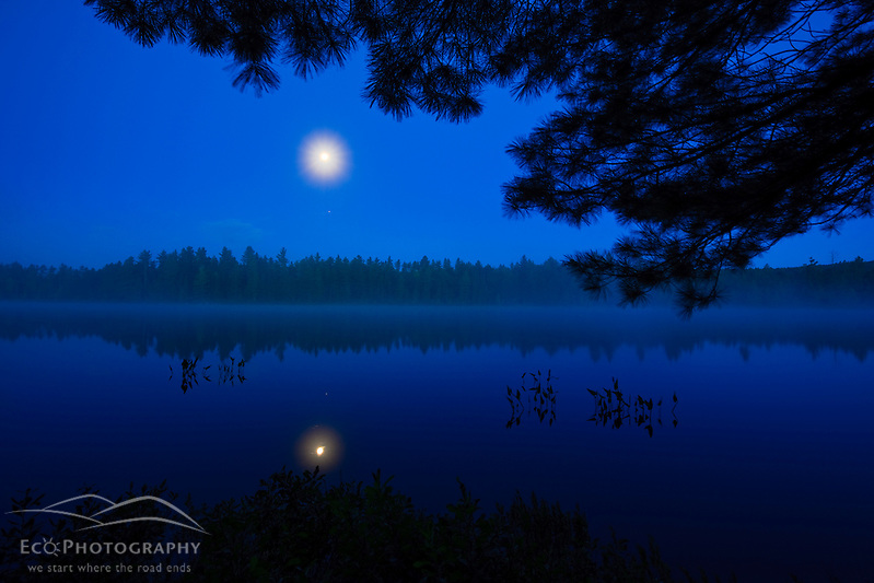 The moon sets over Long Pond in Errol, New Hampshire. (Jerry and Marcy Monkman)