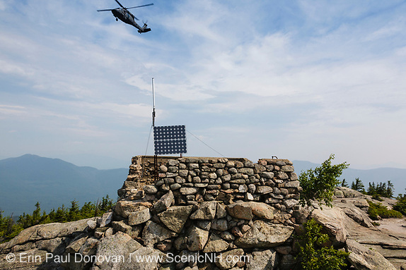 Search and Rescue helicopter flying over Middle Sister Mountain in the White Mountains of New Hampshire.