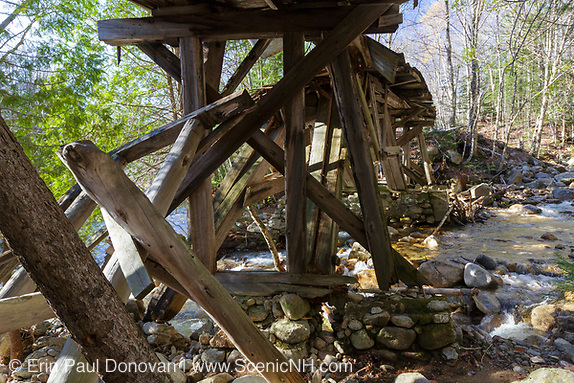 Built in the early 1900s, Trestle No. 16 crosses Black Brook along the old East Branch & Lincoln Railroad (1893-1948) in the Pemigewasset Wilderness of Lincoln, New Hampshire. This image shows how the trestle looked shortly after the October 29-30, 2017 heavy rain and wind storm. The support timbers on the left have been down for some years. But this section of trestle that crosses the brook looks to have shifted some. And more of the stone abutment in the foreground washed away.
