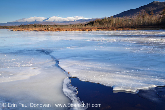 Image of the Presidential Range from Cherry Pond at Pondicherry Wildlife Refuge in Jefferson, New Hampshire. The Presidential Range Rail Trail passes by Cherry Pond.