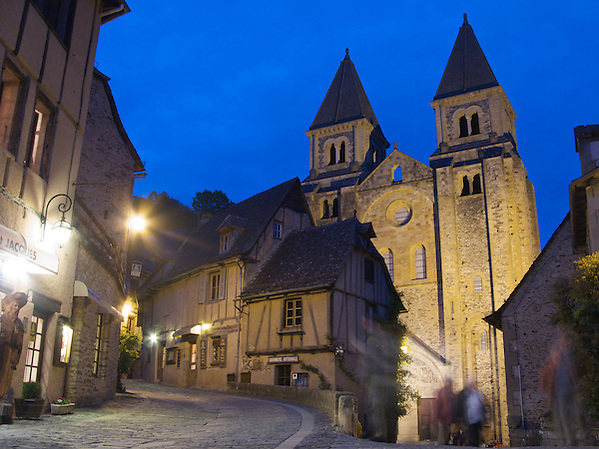 People moved around the front of the Cathedral after returning from restaurants and bars. The old Cathedral is the centrepiece of the World Heritage village of Conques in South-West France. (Richard McCaig)