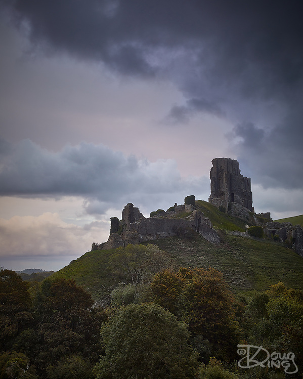 The ruins of Corfe Castle silhouetted against the last light at the moment storm clouds arrive overhead. Storm Alex, 1st October 2020. (Doug King/Doug King Photography)