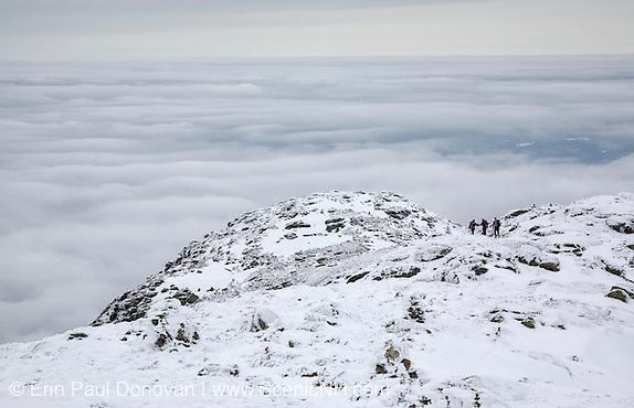Three hikers travel along the Appalachian Trail near Mount Lafayette in the White Mountains, New Hampshire.