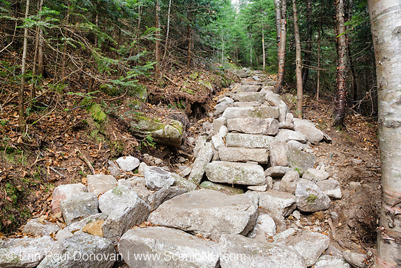 October 2011 -Drainage ditch / Stone steps along the Mount Tecumseh Trail in the White Mountains, New Hampshire USA. The area on the left is in the process of collapsing.  After a trail inspection by Forest Service in June 2012, they (FS) stepped in and took control of ongoing work along this trail. It has been suggested this erosion issue will need to be corrected by a professional trail crew.