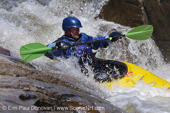 Kayaker going over Lower Falls along the Swift River during the spring months in the White Mountains, New Hampshire.