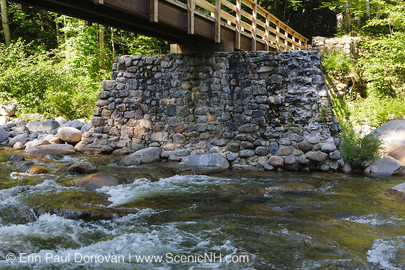Franconia Brook foot bridge in Lincoln, New Hampshire. Abutments from Trestle 7 of the old the East Branch & Lincoln Railroad (1893 - 1948) are used to support this foot bridge.