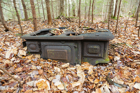 Artifact at Holland Camp which was a logging camp of the Swift River Railroad located in the Sabbaday Brook drainage of the New Hampshire White Mountains. This was a logging railroad in operation from 1906-1916. The Noyes & Goddard stove was produced from 1886-1902.