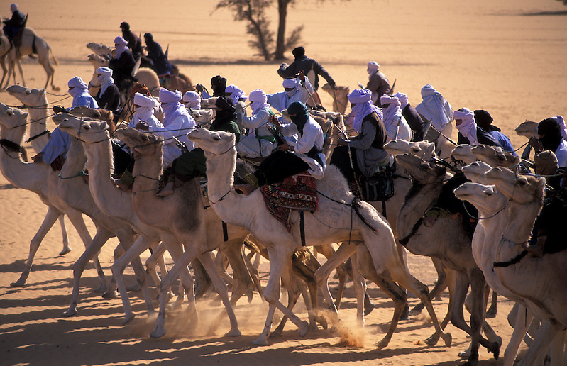 Touaregs riding their camels during the camel festival, Ghat, Libya (Michael Runkel)