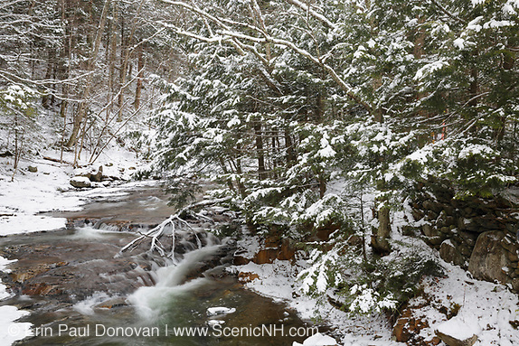 Tunnel Brook in Benton, New Hampshire USA during the winter months. Based on an 1860 historical map of Grafton County this was probably the site of the Brown & Whitcher Saw Mill.