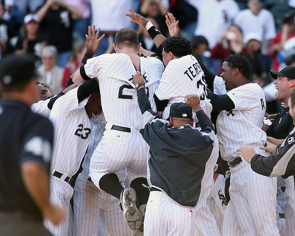 CHICAGO - SEPTEMBER 16:  Teamates mob Jim Thome #25 of the Chicago White Sox after hitting his 500th career home run, a walk off home run winning the game, off of Dustin Moseley #58 during the game against the Los Angeles Angels at U.S. Cellular Field in Chicago, Illinois on September 16, 2007.  The White Sox defeated the Angels 9-7.  (Photo Credit Ron Vesely) (Ron Vesely)