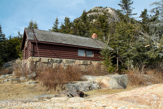 Jim Liberty Cabin in the White Mountains of New Hampshire. This cabin is located along the Liberty Trail about a 1/2 mile from the summit of Mount Chocorua. It was built in 1934 and is secured down by two large chains. It is located at the site of the old Peak House.