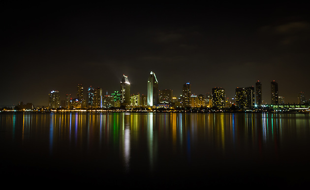 The downtown San Diego city skyline lights up the bay at night.  Viewed from Coronado. (Clint Losee)