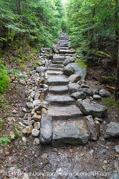 June 2015 - Stone staircase along the Mount Tecumseh Trail in Waterville Valley, New Hampshire during the summer months. Conservation groups suggest that stonework built along trails should be minimal, look natural, and blend in with the surroundings.