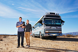 Full-time RV travelers stand next to their 1986 Wanderlodge Class A coach. (Seth K Hughes)