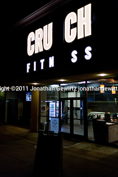 Crunch Fitness storefront with missing letters in illuminated sign. (Copyright 2011 Jonathan Gewirtz jonathan@gewirtz.net)