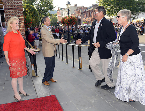 COOPERSTOWN, NY - JULY 26: Hall of Famer Carlton Fisk is greeted by HOF President Jeff Idelson and HOF Chairman Jane Forbes Clark during the annual Parade of Legends down Main Street in Cooperstown, New York on July 26, 2014. (Ron Vesely)
