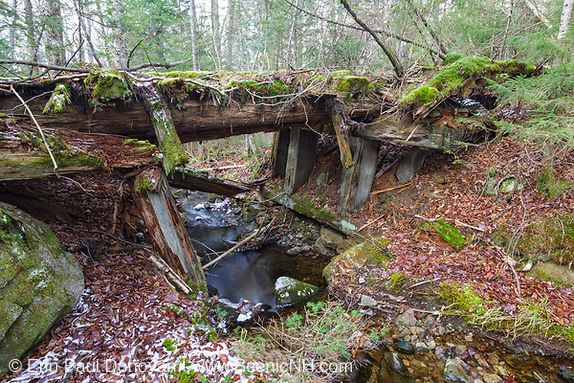 Side view of a decaying timber bridge along the abandoned Boston and Maine Railroad's Mt Washington Branch (between Fabyans and the base of the Cog) in the White Mountains, New Hampshire.