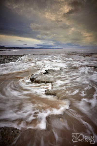 Photo for Sale: The rising tide encroaches onto the Jurassic limestone beds at Lilstock beach on the North Somerset Coast. (Doug King)