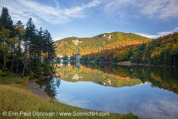 Dixville Notch - Lake Gloriette in Dixville, New Hampshire USA during the autumn months. The Balsams Grand Resort is in view.