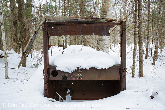 Abandoned truck in the Tunnel Brook drainage of Benton, New Hampshire USA during the winter months. This is possibly a 1920s International truck.