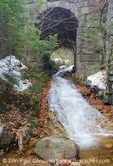 Stone bridge along the old Maine Central Railroad in Harts Location, New Hampshire USA during the spring months. This bridge crosses Kedron Brook.