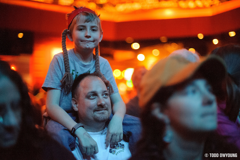 A young Willie Nelson fan wearing the singer's iconic red bandana and braids. (TODD OWYOUNG)