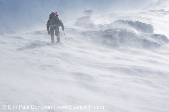 A winter hiker ascends the Airline Trail in extreme weather conditions during the winter months in the White Mountains, New Hampshire USA.