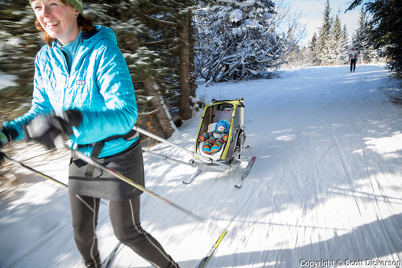 Stephanie Dickerson takes baby Riley out nordic skiing near Homer, Alaska on a sunny winter day. (Scott Dickerson)