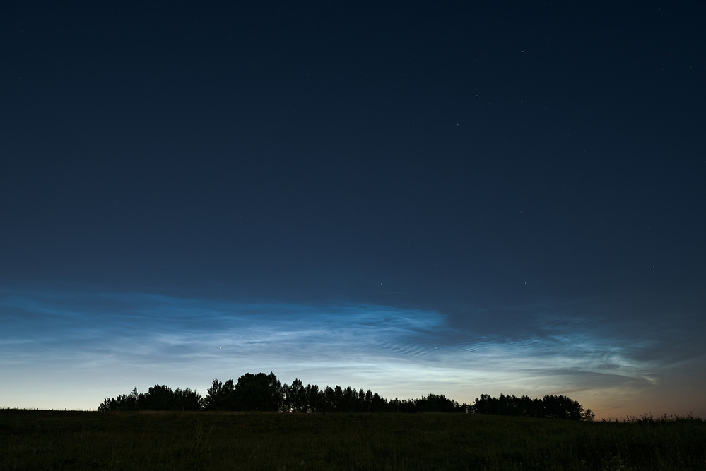 "A group of noctilucent clouds in summer night, nature park ""Dvietes paliene"", Latvia Ⓒ Davis Ulands 