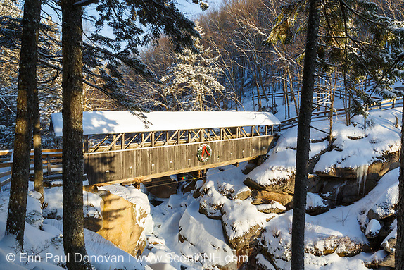 Franconia Notch State Park - Sentinel Pine Covered Bridge during the winter months. It is a footbridge which crosses over the Pemigewasset River in Lincoln, New Hampshire.