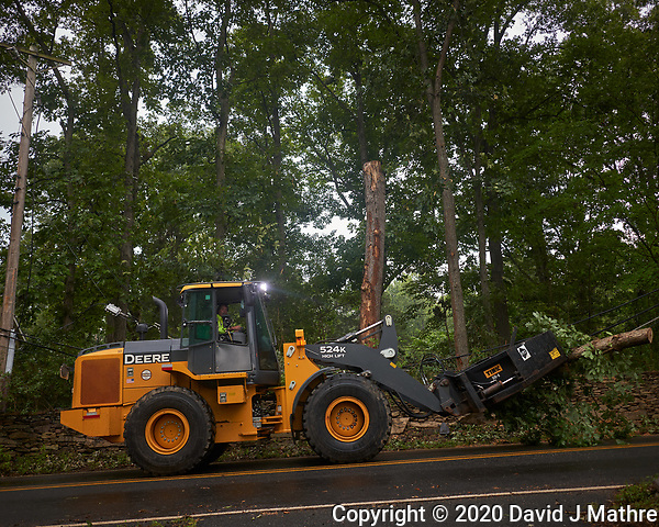 Tropical Storm Isaias Aftermath Day 4. Montgomery Township clearing the downed trees and debris on Grandview Road. Image taken with a Leica CL camera and 18 mm f/2.8 lens (DAVID J MATHRE)