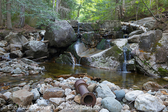 An old dam on Gibbs Brook near Crawford Path in the New Hampshire White Mountains during the spring months. This dam and piping system (out of sight) supplied water to the old Crawford House.