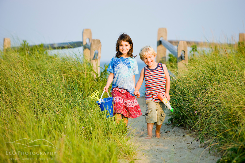 A young brother and sister walk at Center Hill Preserve beach in Plymouth, Massachusetts. (Jerry and Marcy Monkman/EcoPhoto)