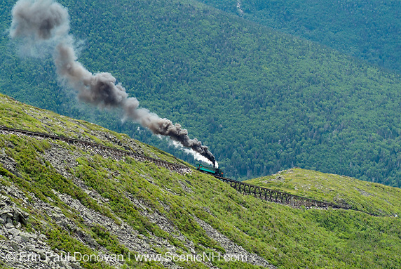 The Mount Washington Cog Railroad ascending Mount Washington during the summer months in the scenic landscape of the White Mountains, New Hampshire.