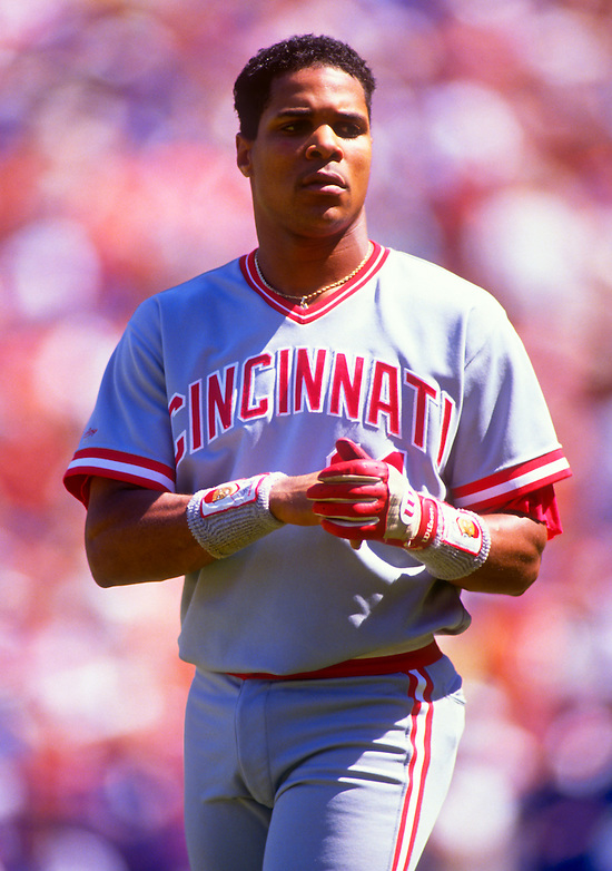 NEW YORK-CIRCA 1989:  Barry Larkin of the Cincinnati Reds looks on against the New York Mets during an MLB game at Shea Stadium in the Queens borough of New York City.  Larkin played for the Reds from 1986-2004.   (Photo by Ron Vesely)   Subject: Barry Larkin. (Ron Vesely)
