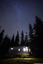 Nighttime camping under the stars in a recreational vehicle at Crater Lake National Park, Oregon. (Seth K Hughes)