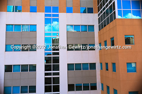 Fragments of the Miami, Florida skyline as reflected from an office building adjacent to a downtown Metromover station. (© 2012 Jonathan Gewirtz / jonathan@gewirtz.net)