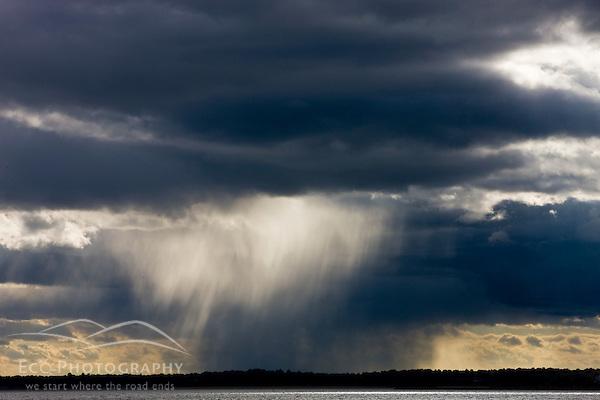 Rain showers over Long Island Sound.
